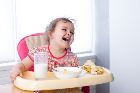 hungry kid: kid girl eating healthy food Stock Photo