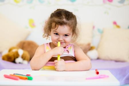 child girl with felt-tip pen Stock Photo - 19093318