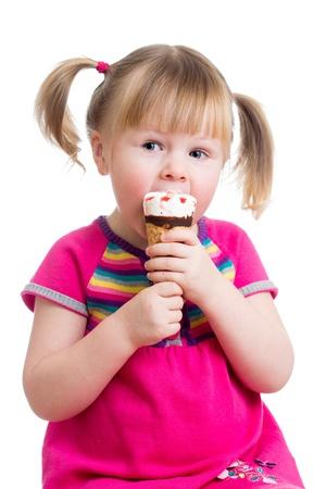 eating ice cream: child girl eating ice cream in studio isolated