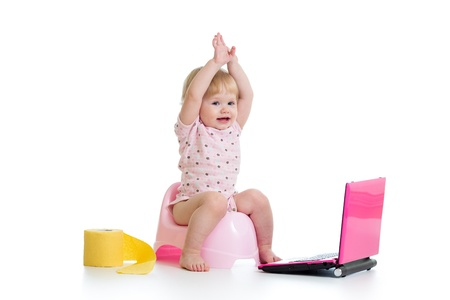 kids laptop: baby girl sitting on chamberpot with notebook