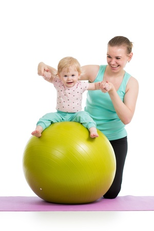 mama: mother with baby having fun with  gymnastic ball