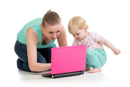 mother and child working at laptop photo