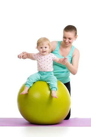 mother with baby having fun with gymnastic ball Stock Photo - 19264861