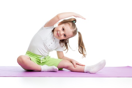 gymnastics girl: Kid doing fitness exercises Stock Photo