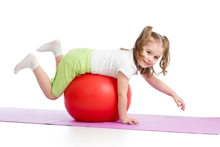 kids exercise: Kid having fun with gymnastic ball isolated