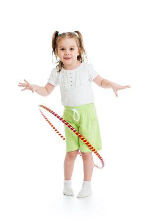 exhilarated: kid girl having fun with hoop isolated