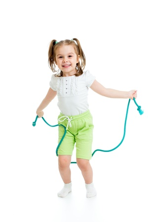 leaping: kid girl jumping with rope isolated
