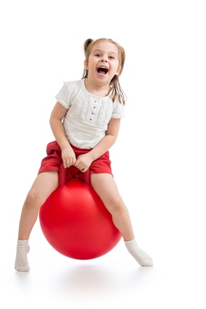 exhilarated: happy child jumping on bouncing ball  Isolated on white
