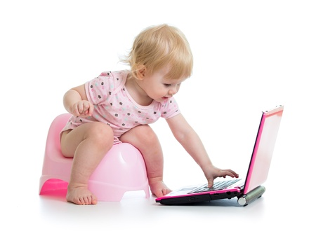 girl toilet: baby girl sitting on chamberpot with notebook