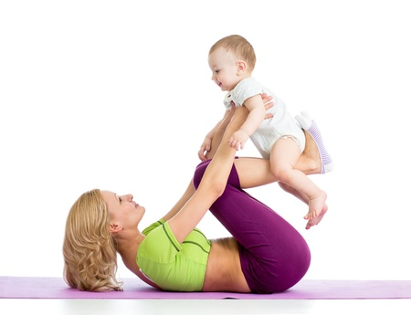 mother with baby doing gymnastics and fitness exercises Stock Photo