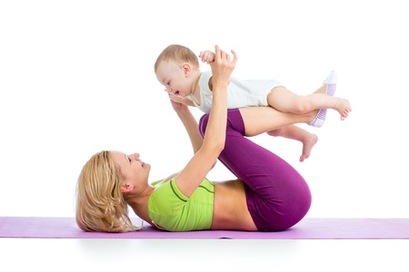 baby with mother: mother with baby doing gymnastics and fitness exercises Stock Photo