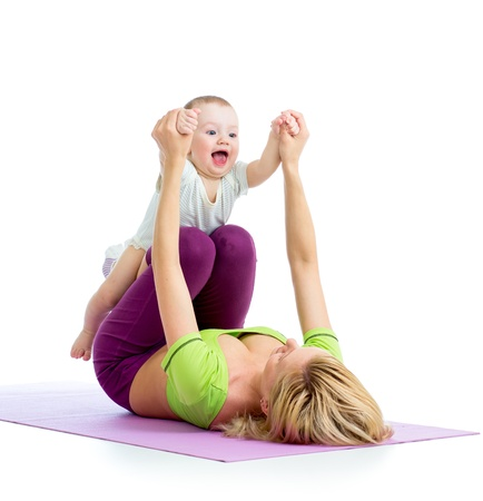 mother with baby doing gymnastics and fitness exercises Фото со стока