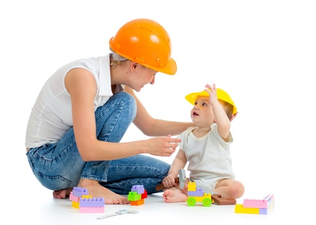 kid and mother play with building blocks toy photo