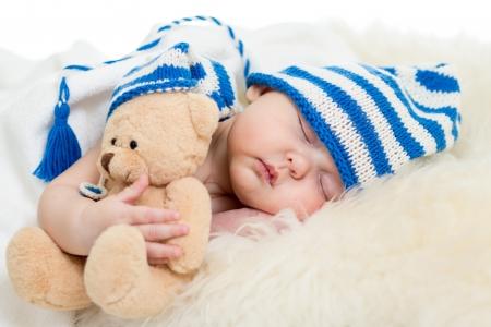 sleeping face: newborn baby sleeping on fur bed Stock Photo