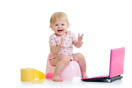 pissing: baby girl sitting on chamberpot with notebook