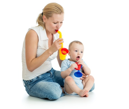 Mother and baby boy having fun with musical toys photo