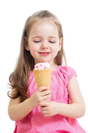 eating ice cream: joyful child girl eating ice cream in studio isolated