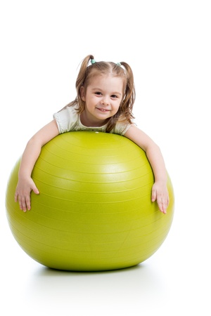 playing games: Kid girl having fun with  gymnastic ball isolated Stock Photo