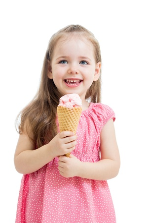 joyful child girl eating ice cream in studio isolated photo