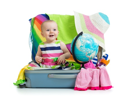 kids dress: Baby girl sitting in suitcase with  things for vacation travel Stock Photo