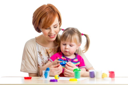 mother and daughter play with dough photo