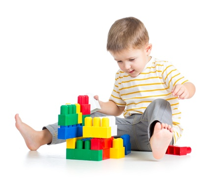 assiduous: kid boy playing with block toy over white background Stock Photo