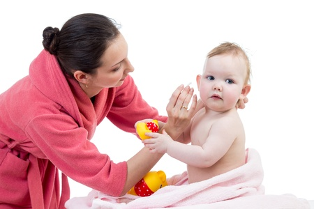 solicitous: mother cleaning ears her baby after bathing