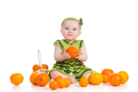happy baby  girl with fruits isolated on white background photo