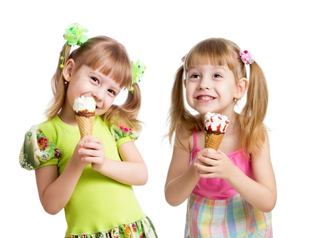 twin sister: happy girls eating ice cream in studio isolated