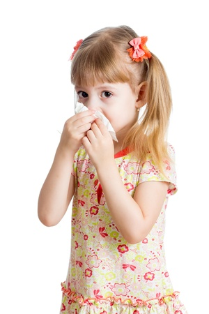 kid girl crying and  cleaning nose with tissue isolated on white photo