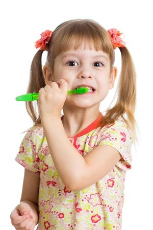 child girl brushing teeth isolated on white background photo