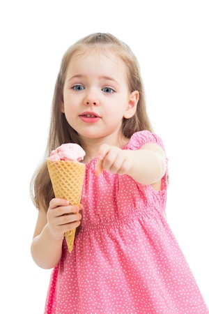 joyful child girl eating ice cream in studio isolated Stock Photo - 20083669
