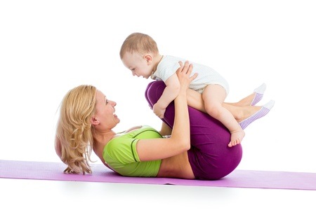 mama: mother with baby doing gymnastics and fitness exercises Stock Photo