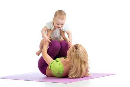 mother with baby doing gymnastics and fitness exercises Reklamní fotografie