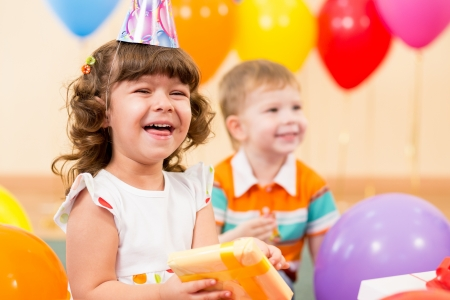 happy child girl with colorful balloons and gift Stock Photo - 20331329
