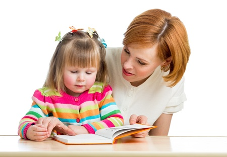 children reading books: mother reading a book kid girl Stock Photo