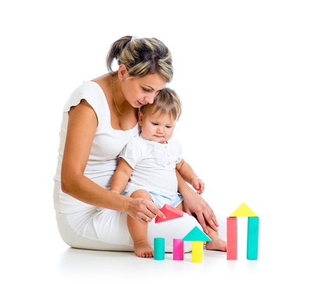 laps: mother and her baby playing building blocks toy