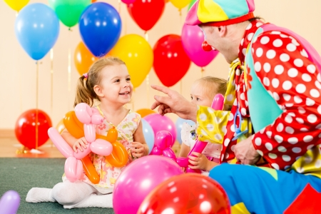 kids birthday party: happy kids and clown on birthday party Stock Photo