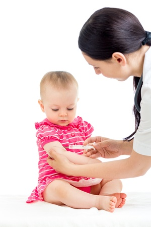 injection: doctor vaccinating child isolated on a white
