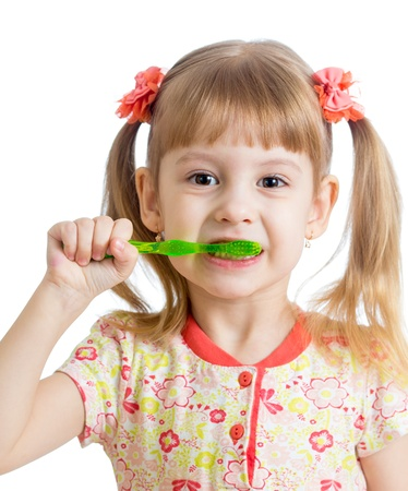 child girl cleaning teeth , isolated on white background photo