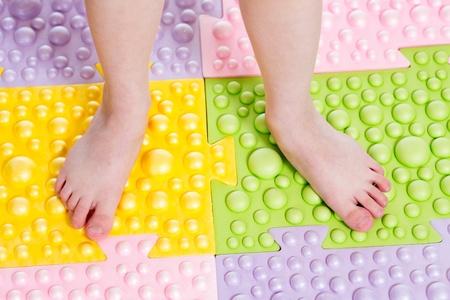 child feet on massaging mat Stock Photo - 20751254