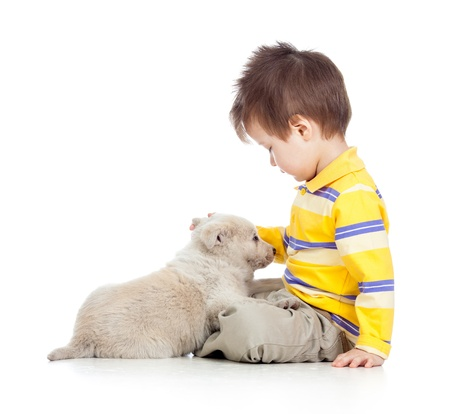 endear: child boy with puppy dog Stock Photo