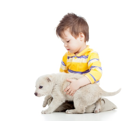 endear: kid boy with puppy dog isolated on white background Stock Photo