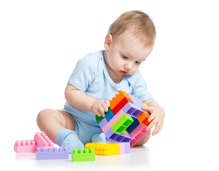 assiduous: child boy playing with block toy over white background Stock Photo