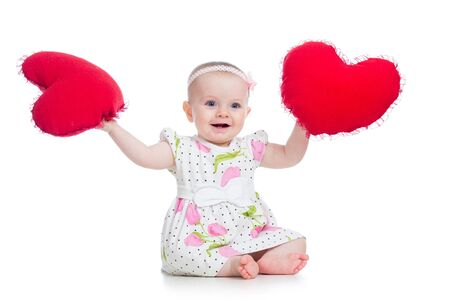 baby girl with pillow in heart shape photo