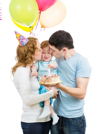 young family celebrating first baby birtday photo