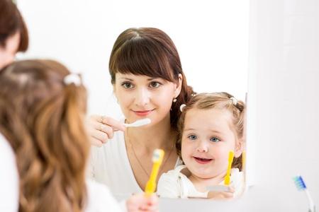 mother instructing kid teeth brushing Stock Photo - 20674677
