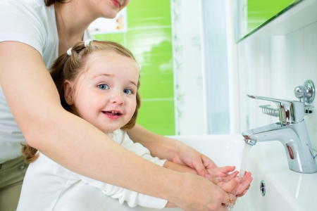 water hand: mother washing baby hands