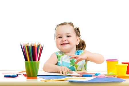 children painting: baby girl drawing and making by hands Stock Photo