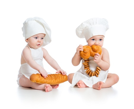 Little bakers babies boy and girl isolated photo